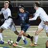 Enid's Ivan Delgadillo dribble between Piedmont's Preston Fansher and Blake Cope Tuesday March 5, 2019 at D. Bruce Selby Stadium. (Billy Hefton / Enid News & Eagle)