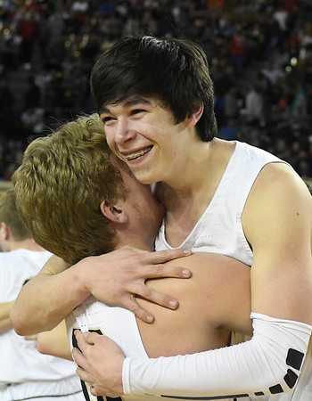 Kingfisher's Bijan Cortes gets a hug from Declan Haub after the Yellowjacket's win over Heritage Hall in the Class 4A state championship game Saturday March 9, 2019 at the Sate Fair Arena in Oklahoma City. (Billy Hefton / Enid News / Eagle)