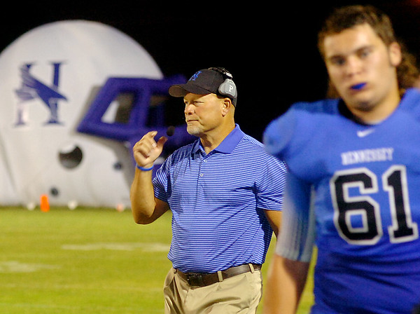 Hennessey head football coach, Rick Luetjen, encourages the Eagles from the sidelines Friday, Sept. 26, 2014. (Staff Photo by BONNIE VCULEK)