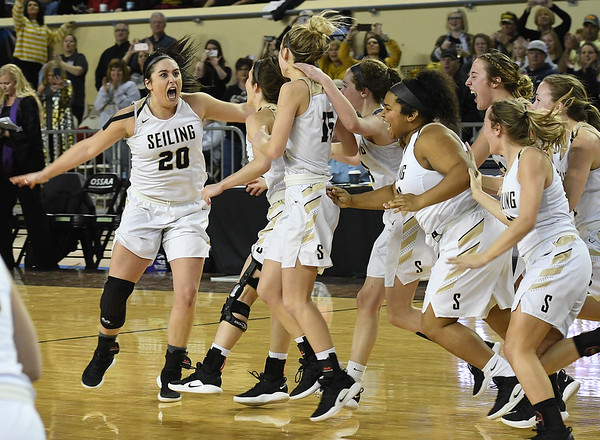 Seiling's Karly Gore (20) lets out a yells as the team rushes the court following the Lady Cats' 76-41 win over Hydro-Eakly in the Class A state championship game Saturday March 2, 2019 at the State Fair Arena in Oklahoma City. (Billy Hefton / Enid News & Eagle)