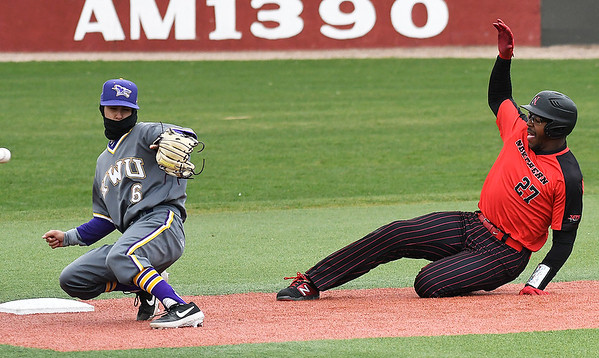NOC Enid's E.J. Taylor slides into second as the ball bounces away from a Kansas Wesleyan player Thursday March 14, 2019 at David Allen Memorial Ballpark. (Billy Hefton / Enid News & Eagle)