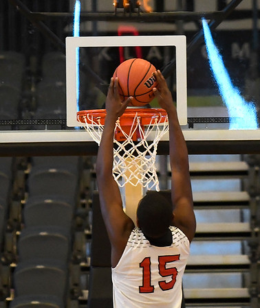 Luther's Syrus Grisby scores a fastbreak dunk during the Lion's 60-35 win over Pioneer in an elimination game in the Class 2A Area I tournament Friday March 1, 2019 at the Central National Bank Center. (Billy Hefton / Enid News & Eagle)