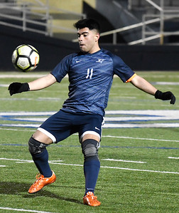 Enid's Marcos Arambula gets control of the ball against Lawton Ike during the season opener at D. Bruce Selby Stadium Friday March 1, 2019. (Billy Hefton / Enid News & Eagle)