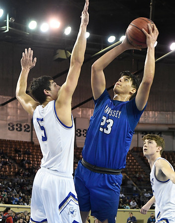 Hennessey's Hugo Rodriguez puts up a shot against Rejoice Christian's Jaden Lietzke in the Class 2A state championship game Saturday March 9, 2019 at the Sate Fair Arena in Oklahoma City. (Billy Hefton / Enid News / Eagle)