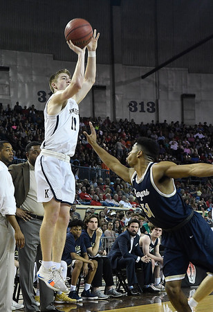 Kingfisher's Jett Sternberger shoots over Heritage Hall's Phillip Smitherman in the Class 4A state championship game Saturday March 9, 2019 at the Sate Fair Arena in Oklahoma City. (Billy Hefton / Enid News / Eagle)