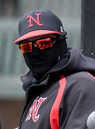 A NOC Enid player dresses to stay warm during a doubleheader against Kansas Wesleyan at David Allen Memorial Ballpark Thursday March 14, 2019. (Billy Hefton / Enid News & Eagle)