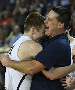 Kingfisher's Jett Sternberger and coach Jared reese hug following the Yellowjacket's win over Heritage Hall in the Class 4A state championship game Saturday March 9, 2019 at the Sate Fair Arena in Oklahoma City. (Billy Hefton / Enid News / Eagle)