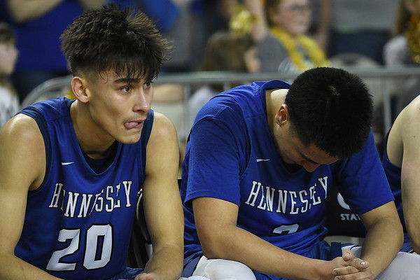 Hennessey's Angel Rodriguez and Brandon Ramirez sit on the bench as final second run off the clock during the Eagles loss to Rejoice Christian in the Class 2A state championship game Saturday March 9, 2019 at the Sate Fair Arena in Oklahoma City. (Billy Hefton / Enid News / Eagle)