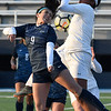 Enid's McKenna Chatterji challenges a Lawton Ike defender for the ball during the season opener at D. Bruce Selby Stadium Friday March 1, 2019. (Billy Hefton / Enid News & Eagle)