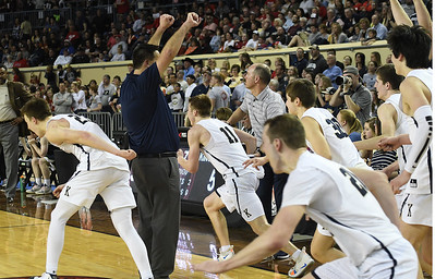 Kingfisher coach Jared Reese raises his fist as players rusch the court following the Yellowjacket's win over Heritage Hall in the Class 4A state championship game Saturday March 9, 2019 at the Sate Fair Arena in Oklahoma City. (Billy Hefton / Enid News / Eagle)