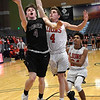 Pioneer's Ty Dennett drives to the basket against Luther's Tyler Becker during an elimination game in the Class 2A Area I tournament Friday March 1, 2019 at the Central National Bank Center. (Billy Hefton / Enid News & Eagle)