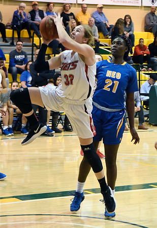 NOC Enid's Sarah Griswold gets by NEO's Bethy Mununga during the Region 2 championship game DSaturday March 9, 2019 at Oklahoma Baptist University in Shawnee. (Billy Hefton / Enid News & Eagle)