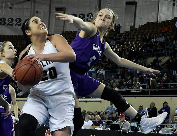 Seiling's Karly Gore shoots puts up a shot against Hydro_eakly's Macey Buss during the Lady Cats' 76-41 win over Hydro-Eakly in the Class A state championship game Saturday March 2, 2019 at the State Fair Arena in Oklahoma City. (Billy Hefton / Enid News & Eagle)