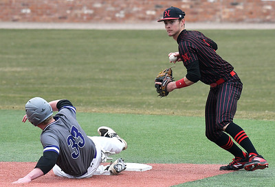 NOC Enid's D.J. Calvert looks to first after forcing out Ellsworth CC's Tommy Auth Friday March 8, 2019 at David Allen Memorial Ballpark. (Billy Hefton / Enid News & Eagle)