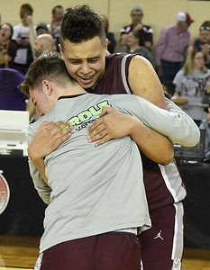 Garber's Taye Sullivan hugs a team mate following their 53-51 double overtime win over Arapho-Butler in the Class A state championship Saturday, March 7, 2020 at the State Fair Arena in Oklahoma City. (Billy Hefton / Enid News & Eagle)