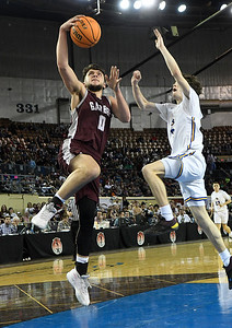 Garber's Sha Nartin goes up for a basket against Arapho-Butler's Ethan Pyron in the Class A state championship Saturday, March 7, 2020 at the State Fair Arena in Oklahoma City. (Billy Hefton / Enid News & Eagle)