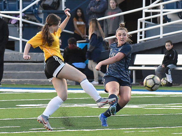 Enid's Kelci Wilson plays the ball forward against Midwest City Tuesday, March 3, 2020 at D. Bruce Selby Stadium. (Billy Hefton / Enid News & Eagle)