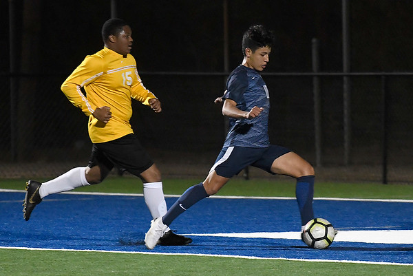 Enid's Miguel Chavez gets behind Midwest City defenders to score Tuesday, March 3, 2020 at D. Bruce Selby Stadium. (Billy Hefton / Enid News & Eagle)