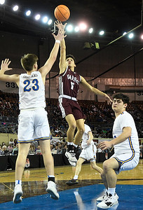 Garber's T.J. Bennett shoots over Arapho-Butler's Jace Edelen in the Class A state championship Saturday, March 7, 2020 at the State Fair Arena in Oklahoma City. (Billy Hefton / Enid News & Eagle)