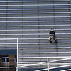 A lone drummer sits in the band section at D. Bruce Selby Stadium Tuesday, March 3, 2020 during the Enid Midwest City soccer game. (Billy Hefton / Enid News & Eagle)