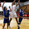 NOC Enid's Teyon Scanlan grabs a rebound between Eastern's Alvin Miles and Braylen Duncan Thursday, March 4, 2021 at the NOC Mabee Center. (Billy Hefton / Enid News & Eagle)