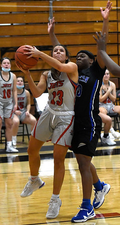 NOC Enid's Abbey Phibbs goes against Eastern's Tijanae Simmons Thursday, March 4, 2021 at the NOC Mabee Center. (Billy Hefton / Enid News & Eagle)