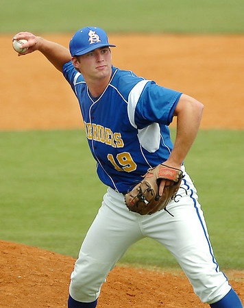 Southern Arkansas pitcher, Jon Mark Abbey, throws to first for an out against Henderson State during an elimination game Monday in the Great American Conference tournament. (Staff Photo by BILLY HEFTON)