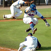 Murray State's Josh Ingram leaps over Kyle Shields of Brunswick Community College after Shields made a sliding catch Saturday during the NJCAA Div II World Series at David Allen Ballpark. (Staff Photo by BILLY HEFTON)