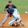 Brady Capshaw of Southern Arkansas Victor Guerra of Harding collide at second base following a force out during the opening game of the Great American Conference tournament Saturday at David Allen Memorial Ballpark. (Staff Photo by BILLY HEFTON)