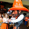 Pistol pete sign an autograph for a young fan Monday during the OSU Caravan stop at Oakwood Country Club. (Staff Photo by BILLY HEFTON)