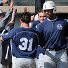 Lackawanna Falcons celebrate Ned Kerr's score during the opening game of the 75th annual NJCAA World Series Division II at David Allen Memorial Ballpark Saturday, May 25, 2013. (Staff Photo by BONNIE VCULEK)