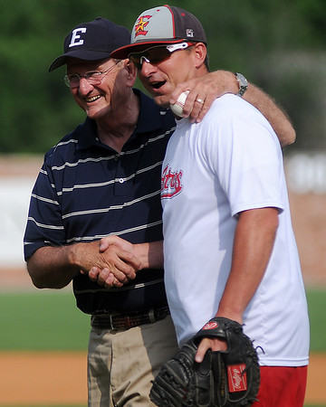 Enid Mayor Bill Shewey and Steve Groeke share a laugh after Shewey threw out the first pitch to Groeke during the opening ceremony in the 75th annual National Junior College Athletic Association Division II World Series at David Allen Memorial Ballpark Friday, May 24, 2013. (Staff Photo by BONNIE VCULEK)