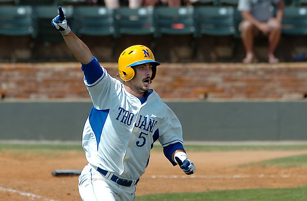North Iowa's Hunter King raises his arm as he rounds the bases after hitting a walk-off home run in the bottom of the 11th inning against Murray State MOnday in the NJCAA Div II World Series Monday at david Allen Ballpark. (Staff Photo by BILLY HEFTON)