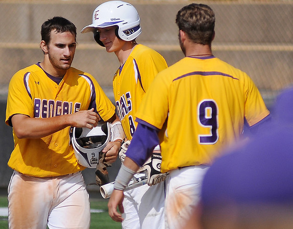 LSU-Eunice's Landon Thibodeaux (left) receives congratulations from his team after he scores the Bengals' first run against Lackawanna College during the 75th annual NJCAA World Series Division II opening game. The Bengals beat the Falcons 4-3. (Staff Photo by BONNIE VCULEK)