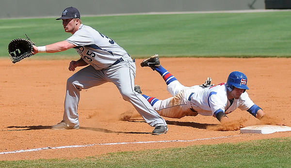 Murray State Aggies' Jared Sterling dives safely back to first as Heartland Community College Hawks' Kenny Mahala awaits the throw during the Aggies 6-0 win during the 75th annual NJCAA World Series Div. II at David Allen Memorial Ballpark Thursday, May 30, 2013. (Staff Photo by BONNIE VCULEK)