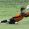 Red Star goalie, Teegin Hacker, makes a save during the finals of the U-10 Enid Soccer Club Spring Recreational Tournament Sunday at the Enid Soccer Complex. (Staff Photo by BILLY HEFTON)