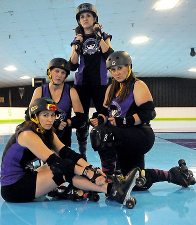 Enid Roller Girls' Tsai N' Hyde, Kelley Rip-Her, Scream & Sugar and Sassy Wrecker (from left) are ready for battle against their next opponent at Skatetown Saturday, June 1, 2013. (Staff Photo by BONNIE VCULEK)