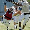 Enid's Sam Clemens (left) dives for the ball and breaks up the pass as Clemens and Aaron Beagle defend against offensive wide receiver Devin Pratt during the Plainsmen's spring practice Wednesday, May 22, 2013. (Staff Photo by BONNIE VCULEK)
