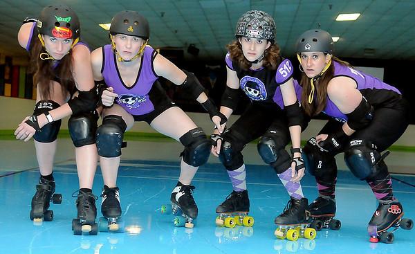 Enid Roller Girls' Tsai N' Hyde, Kelley Rip-Her, Scream & Sugar and Sassy Wrecker are ready for battle against their next opponent at Skatetown Saturday, June 1, 2013. (Staff Photo by BONNIE VCULEK)