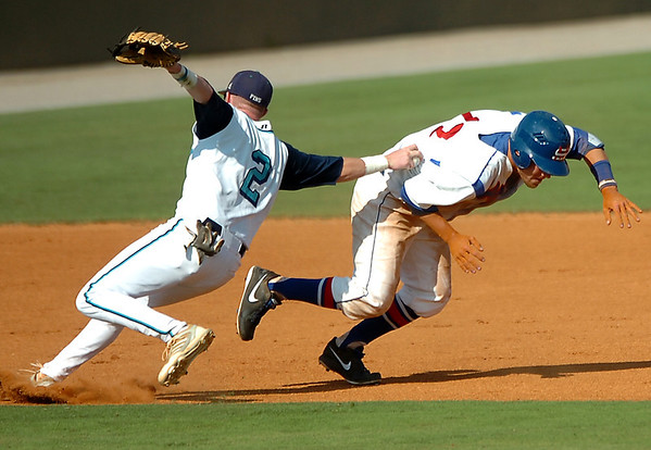 Hunter Allen of Brunswick Community College tags out Murray State's Jared Sterling during the NJCAA Div II World Series Saturday at David Allen Ballpark. (Staff Photo by BILLY HEFTON)