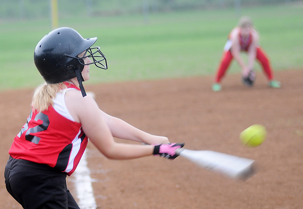 Heat's Avery Dugger connects for a single during a game against the Cherry Bombz in the Summer Smash 10-under softball tournament at Government Springs Park Saturday, May 18, 2013. (Staff Photo by BONNIE VCULEK)