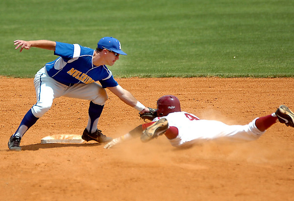 Tyler Cameron of Southern Arkansas tags out henderson State's Tadarious Hawkins during an elimination game Monday in the Great American Conference tournament. (Staff Photo by BILLY HEFTON)