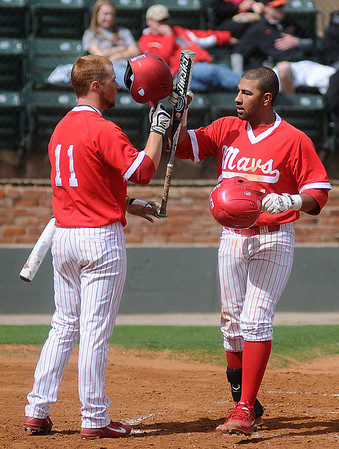 NOC Tonkawa's Skyler Ortiz (right) celebrates his homerun shot over the right field wall with a teammate during a game against the NOC-Enid Jets at David Allen Memorial Ballpark Friday, May 3, 2013. (Staff Photo by BONNIE VCULEK)