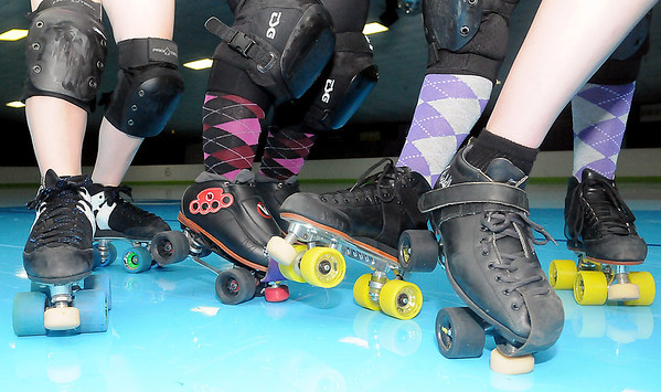 Enid Roller Girls are ready to battle their opponents at Skatetown this Saturday. The Women's Flat Track Roller Derby is one of the fastest growing women's sports in the world. Anyone, 18 or older, interested in lacing up their skates can join the fun. (Staff Photo by BONNIE VCULEK)