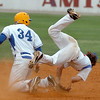 North Iowa's Drew Verstegen upends Murray State's Colt Pickens while trying to break up a double play during an elimination game Wednesday in the NCJAA Div II World Series at David Allen Ballpark. (Staff Photo by BILLY HEFTON)