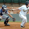 Harding's Trent Wooldridge connects on a RBI single against SWOSU Sunday during an elimination game in the Great American Conference tournament at David Allen Memorial Ballpark. (Staff Photo by BILLY HEFTON)