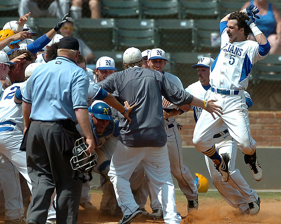 North Iowa's Hunter King (5) leaps on home plate after hitting a walk-off home run in the bottom of the 11th inning against Murray State MOnday in the NJCAA Div II World Series Monday at david Allen Ballpark. (Staff Photo by BILLY HEFTON)