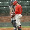 NOC-Enid's Chase Knott and NOC-Tonkawa catcher Haskell Browning stand at the plate during a rain shower Wednesday at David Allen Memorial Ballpark. (Staff Photo by BILLY HEFTON)
