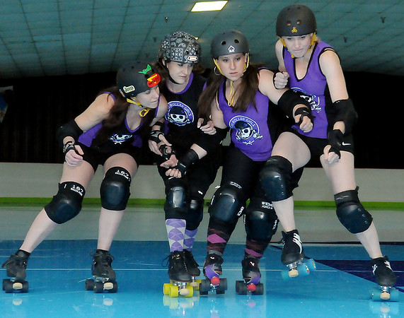 Enid Roller Girls' Tsai N' Hyde, Scream & Sugar, Sassy Wrecker and Kelley Rip-Her (from left) rehearse for their next bout at Skatetown Thursday, May 30, 2013. (Staff Photo by BONNIE VCULEK)