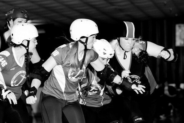 I Owe A Beatin (right) clears the way for the Enid Roller Girls. (Photo Courtesy of PETE RAMOS)